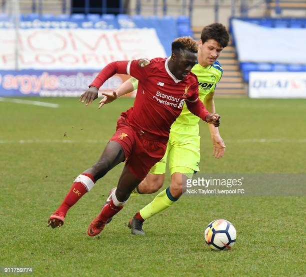 Bobby Adekanye of Liverpool competes with Sven Karic of Derby County during the Premier League 2 match between Liverpool and Derby County at Prenton...
