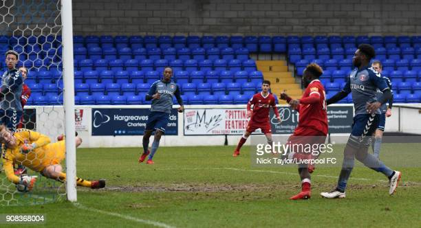 Bobby Adekanye of Liverpool scores the opening goal as Charlton Athletic goalkeeper Ashly MaynardBrewer tries in vain to keep the shot from crossing...