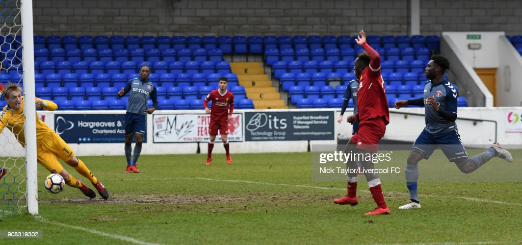 Bobby Adekanye of Liverpool scores the opening goal during the Liverpool U23 v Charlton Athletic U23 Premier League Cup game at The Swansway Chester Stadium on January 21, 2018 in Chester, England.