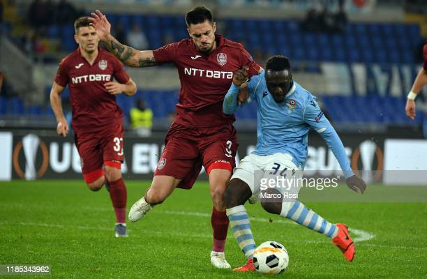 Bobby Adekanye of SS Lazio compete for the ball with Andrei Burca of CFR Cluj during the UEFA Europa League group E match between Lazio Roma and CFR...