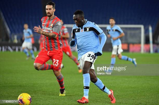 Bobby Adekanye of SS lazio competes for the ball with Antonio Caracciolo during the Coppa Italia match between SS Lazio and US Cremonese at Olimpico...