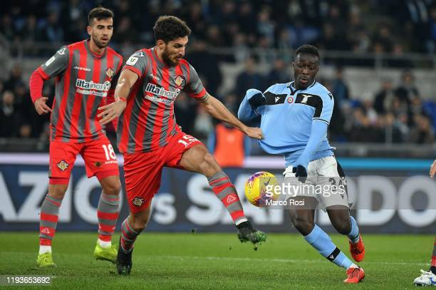 Bobby Adekanye of SS lazio competes for the ball with Matteo Binchetti during the Coppa Italia match between SS Lazio and US Cremonese at Olimpico...