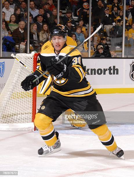 Bobby Allen of the Boston Bruins skates for the puck against the New York Islanders at the TD Banknorth Garden on November 23 2007 in Boston...