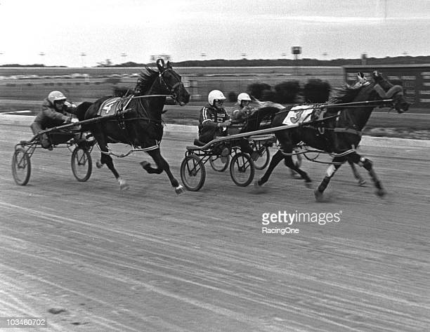 Bobby Allison Dale Earnhardt and Cale Yarborough give it their all in a prerace exhibition harness race at Dover Downs the day before the MasonDixon...