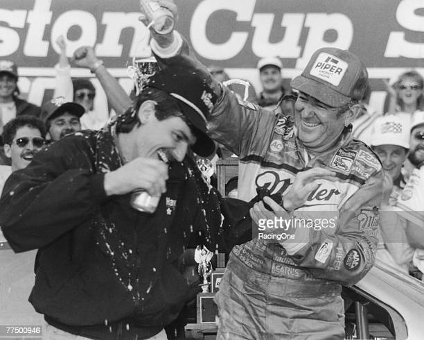 Bobby Allison driver of the Buick celebrates with his son Davey driver of the Robert Yates Racing TexacoHavoline Ford after winning the 1988 NASCAR...
