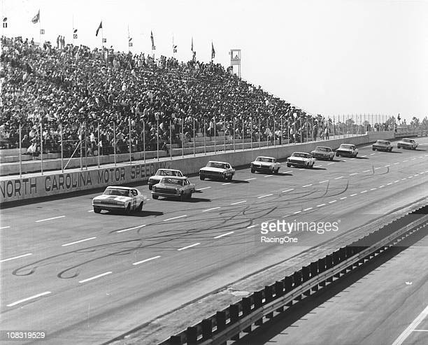 Bobby Allison driving Cotton OwensÕ Dodge Charger leads the field during the running of the Carolina 500 NASCAR Cup race at North Carolina Motor...