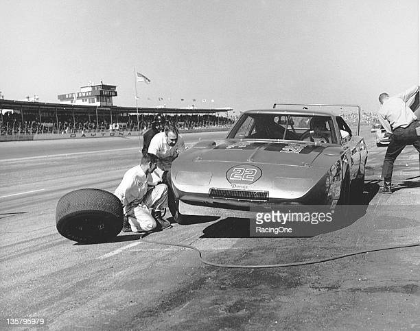 Bobby Allison makes a pit stop in Mario Rossi's Dodge Charger Daytona during a NASCAR Cup race at Daytona International Speedway Allison scored third...