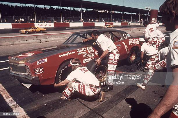 Bobby AllisonÕs pit crew go to work on his NASCAR Cup Chevrolet during a race at Darlington Raceway wearing their unique Coca-Cola uniforms. After...