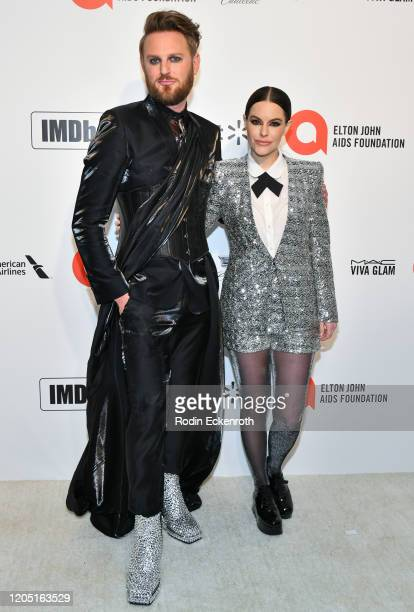 Bobby Berk and Emily Hampshire attend the 28th Annual Elton John AIDS Foundation Academy Awards Viewing Party Sponsored By IMDb And Neuro Drinks on...