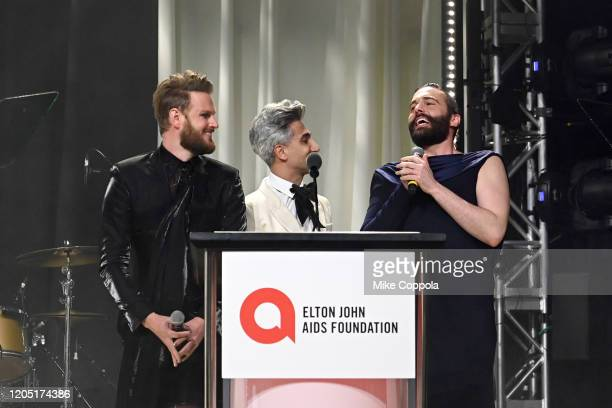 Bobby Berk Tan France and Jonathan Van Ness speak on stage at the 28th Annual Elton John AIDS Foundation Academy Awards Viewing Party sponsored by...