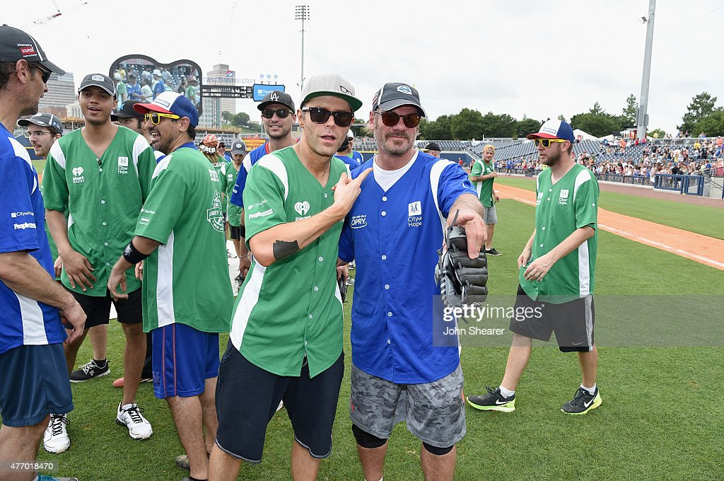 Bobby Bones and Phil Vassar steps up to strike out cancer at City of Hope's 25th Annual Celebrity Softball Game at First Tennessee Park on June 13, 2015 in Nashville, Tennessee.