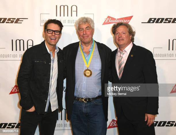 Bobby Bones Coran Capshaw and John Ettinger backstage at the Innovation In Music Awards on June 3 2018 in Nashville Tennessee