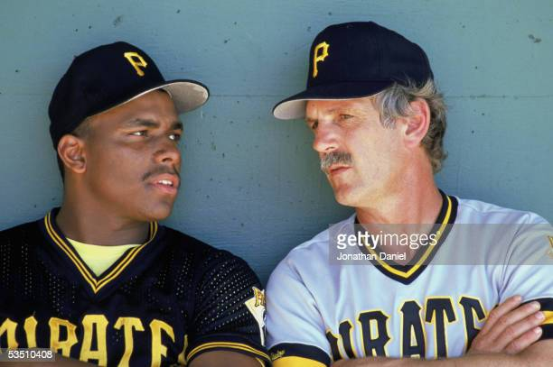 Bobby Bonilla of the Pittsburgh Pirates listens to managers Jim Leyland during a 1989 MLB season game.