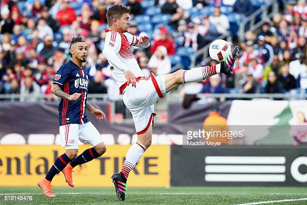 Bobby Boswell of DC United clears the ball during the second half against the New England Revolution at Gillette Stadium on March 12 2016 in Foxboro...