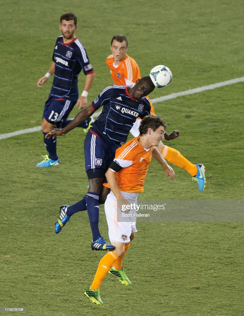 Bobby Boswell #32 of the Houston Dynamo battles for the ball against Bakary Soumare #4 of the Chicago Fire at BBVA Compass Stadium on July 27, 2013 in Houston, Texas.