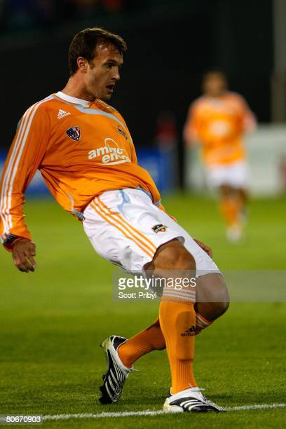 Bobby Boswell of the Houston Dynamo crosses the ball against the Kansas City Wizards during the game at Community America Ballpark on April 12 2008...