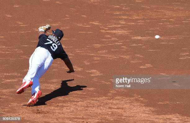 Bobby Bradley of the Cleveland Indians cannot come up with a diving stop at first base in the third inning of a spring training game against the...
