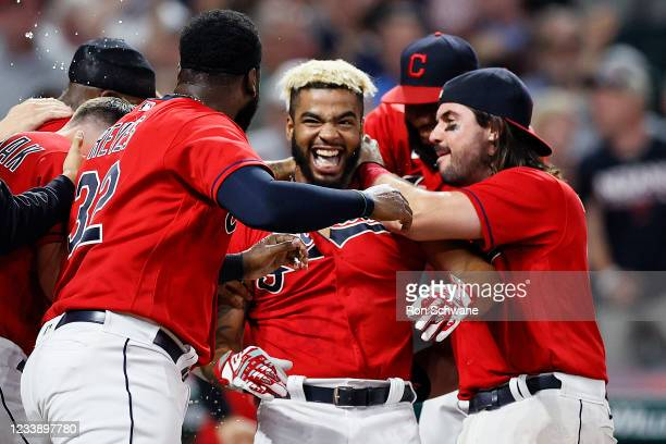 Bobby Bradley of the Cleveland Indians celebrates with Franmil Reyes and Austin Hedges after hitting a game winning solo home run off Jake Brentz of...