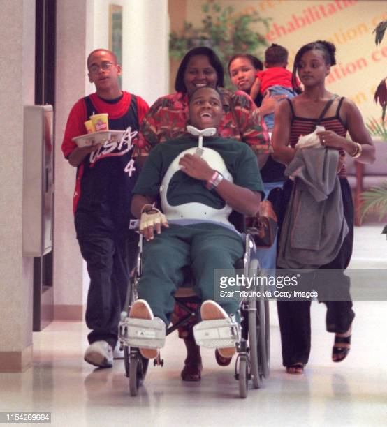 Bobby Brown 15 is surrounded by family members Ava Brown Zachariah BabingtonJohnson 13 and his sister LaVonne 18 and her daughter Samayah 10months...