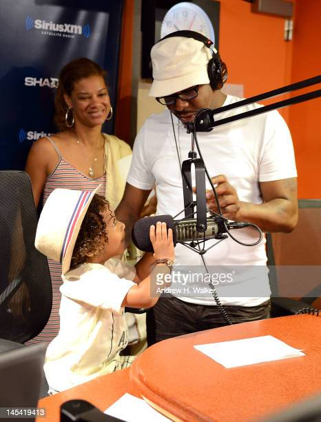 Bobby Brown and fiance Alicia Etheredge watch as their son Cassius Brown talks on the microphone during a visit to Sway in the Morning on Eminem's...