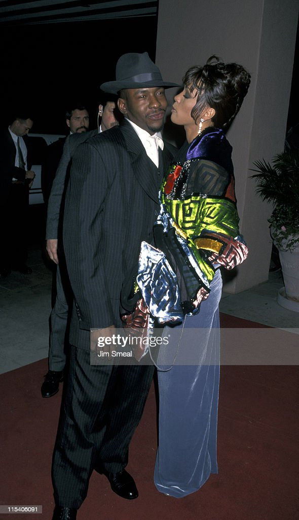 Bobby Brown and Whitney Houston during The 38th Annual GRAMMY Awards - Arista Records Pre-GRAMMY Party at Beverly Hills Hotel in Beverly Hills, California, United States.