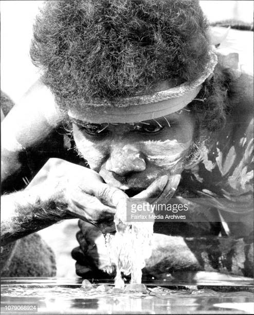 Bobby Bumumgur a songman from the Ramangining Performers takes a drink from the water fountain opposite the Paddington Town Hall after today's...