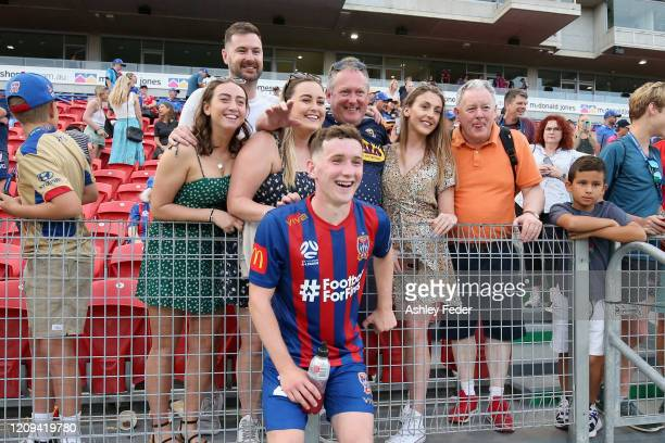 Bobby Burns of the Newcastle Jets talks with fans after winning during the round 21 A-League match between the Newcastle Jets and the Perth Glory at...