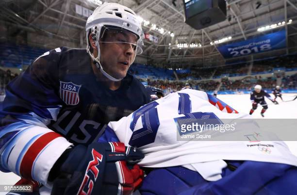 Bobby Butler of the United States tangles with Dominik Granak of Slovakia during the Men's Ice Hockey Preliminary Round Group B game at Gangneung...