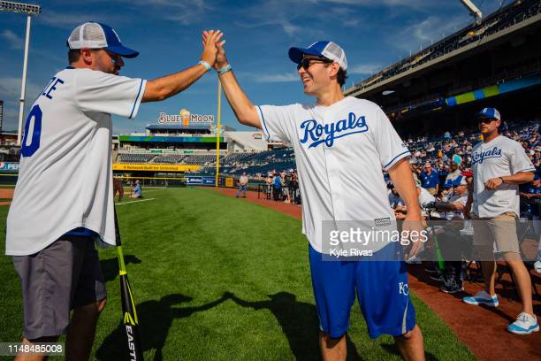 Bobby Cannavale highfives Paul Rudd while playing in the celebrity softball game at Kauffman Stadium during the Big Slick Celebrity Weekend...