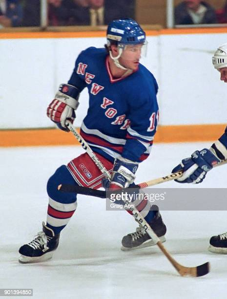 Bobby Carpenter of the New York Rangers skates against the Toronto Maple Leafs during NHL game action on February 25 1987 at Maple Leaf Gardens in...
