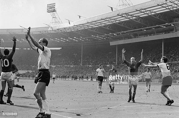 Bobby Charlton and West German players protesting after Geoff Hurst scored a controversial goal during the 1966 World Cup final at Wembley Stadium...