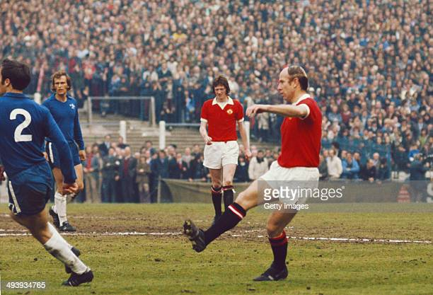 Bobby Charlton in action on his last appearance for United watched by Arnie Sidebottom of United during the League Division One match between Chelsea...