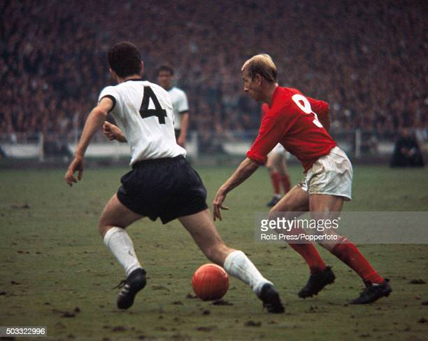 Bobby Charlton of England is closely followed by Franz Beckenbauer of West Germany during the FIFA World Cup Final between England and West Germany...