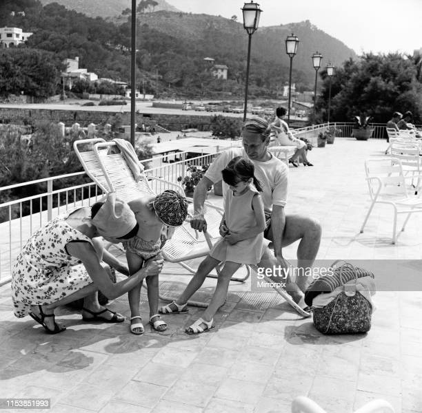 Bobby Charlton on holiday in Cala San Vicente Majorca with his wife Norma and daughters Suzanne and Andrea 12th June 1968