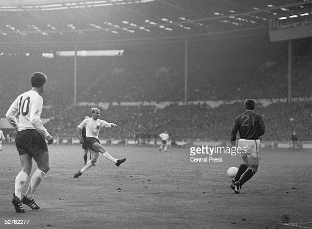 Bobby Charlton scores England's second goal as Portugal's Jose Carlos runs in to try and intercept during the World Cup semifinal match at Wembley...