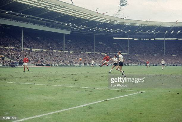 Bobby Charlton volleys the ball during the World Cup Final at Wembley Stadium 30th July 1966 England went on to win the match 42