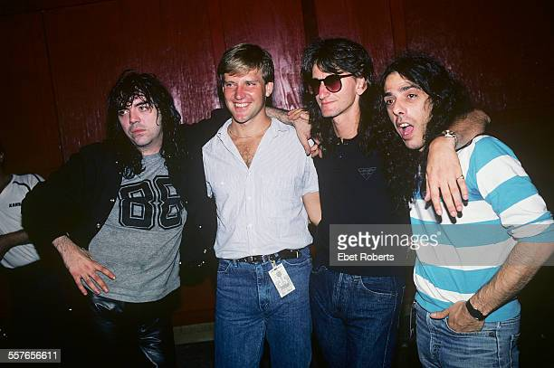 Bobby Chouinard Alex Lifeson and Geddy Lee of Rush and unknown backstage at a benefit concert at The Pier in New York City on July 23 1983