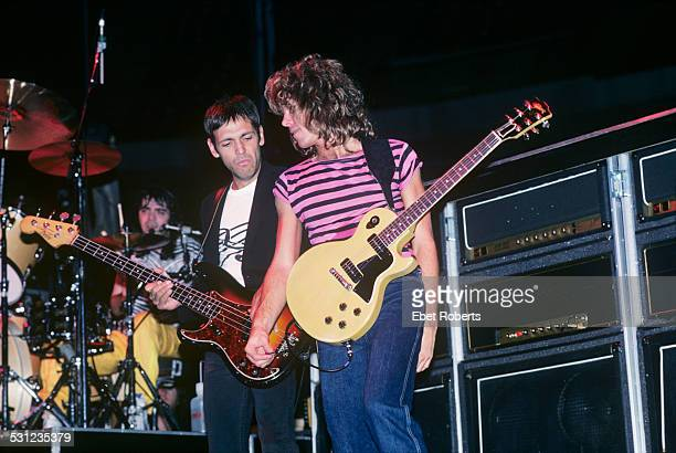 Bobby Chouinard, bassist Doug Lubahn and Jeff Golub of the Billy Squier Band performing at the Brendan Byrne Arena in East Rutherford, New Jersey on...