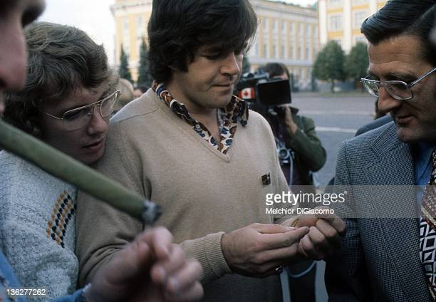 Bobby Clarke and Dale Tallon of Canada show off their pins to agent Alan Eagleson while touring Moscow during the 1972 Summit Series against the...