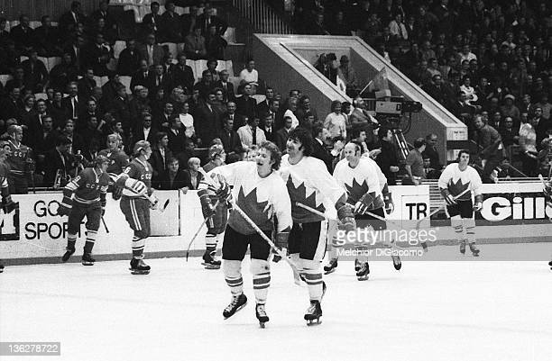 Bobby Clarke and Guy Lapointe of Canada celebrate on the ice after their game with the Soviet Union in the 1972 Summit Series at the Luzhniki Ice...