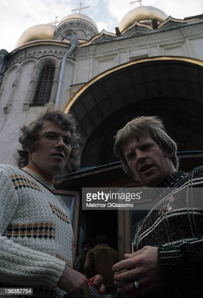 Bobby Clarke and Pat Stapleton of Canada pose in front of the Archangel Cathedral while touring Moscow during the 1972 Summit Series in Moscow Russia