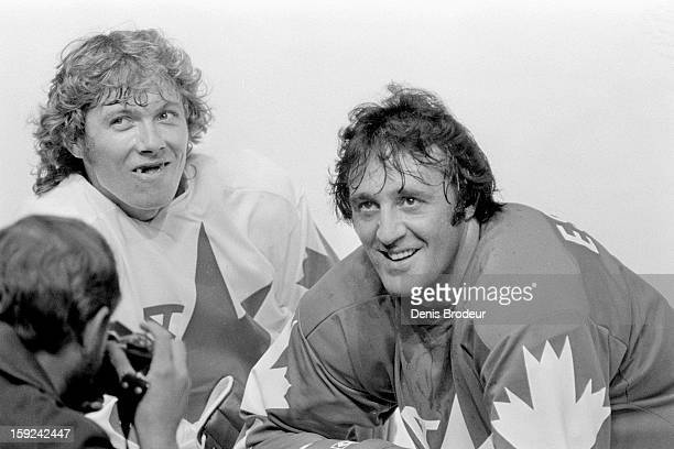 Bobby Clarke and Phil Esposito of team Canada have a discussion during practice for the Canada Cup series at the Montreal Forum circa September 1976...
