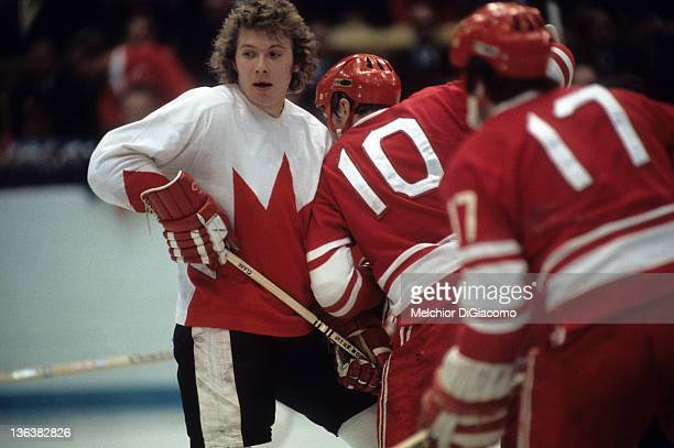 Bobby Clarke of Canada is checked by Aleksandr Maltsev of the Soviet Union during the 1972 Summit Series at the Luzhniki Ice Palace in Moscow Russia