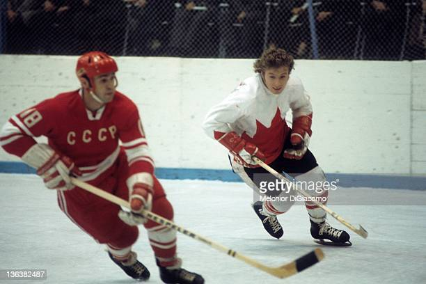 Bobby Clarke of Canada looks to defend against Vladimir Vikulov of the Soviet Union during the 1972 Summit Series at the Luzhniki Ice Palace in...