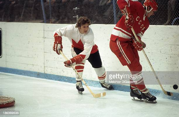 Bobby Clarke of Canada looks to steal the puck from Yuri Shatalov of the Soviet Union during the 1972 Summit Series at the Luzhniki Ice Palace in...