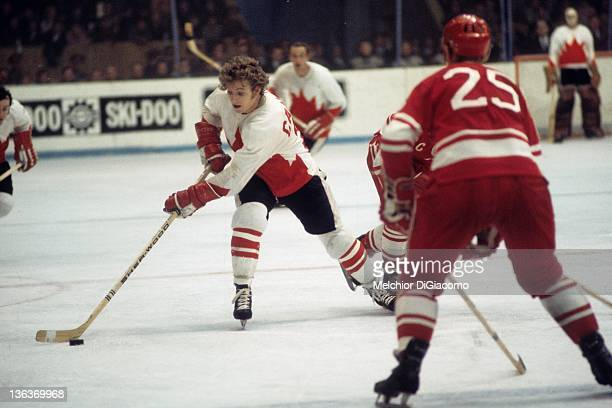 Bobby Clarke of Canada skates with the puck as Yuri Liapkin of the Soviet Union defends during the 1972 Summit Series at the Luzhniki Ice Palace in...