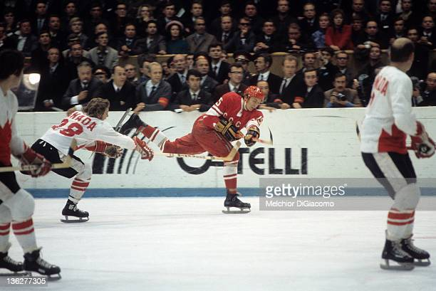 Bobby Clarke of Canada tries to block the shot of Alexander Yakushev of the Soviet Union during the 1972 Summit Series at the Luzhniki Ice Palace in...