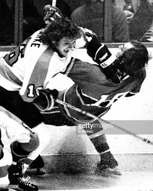 Bobby Clarke of the Philadelphia Flyers drops Guy Lafleur of the Montreal Canadiens during their game on March 24 1975 at the Spectrum in...
