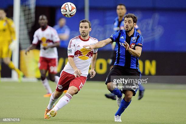 Bobby Convey of the New York RedBulls and Hernan Bernardello of the Montreal Impact battle for the ball during the MLS game at the Olympic Stadium on...