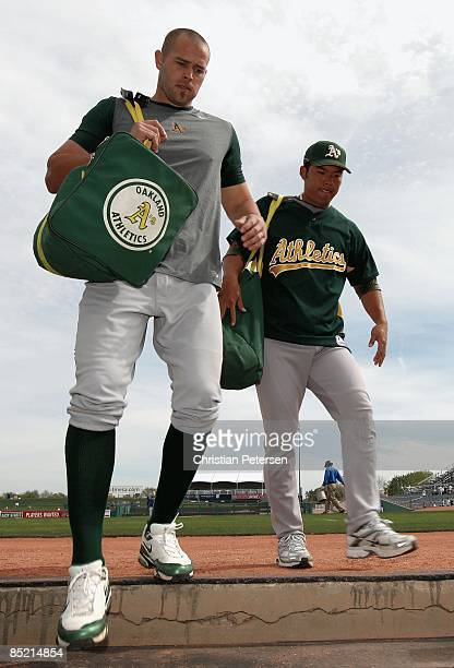Bobby Crosby and Kurt Suzuki of the Oakland Athletics walk into the dugout before the spring training game against the Chicago Cubs at HoHoKam Park...